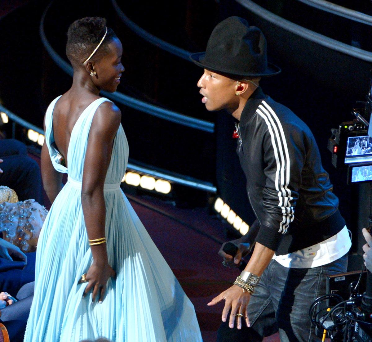 Lupita Nyongo dances with Pharrell Williams at the 2014 Oscars (image courtesy of www.nydailynews.com )